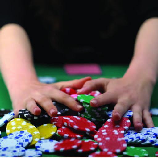 hands pushing away gambling chips