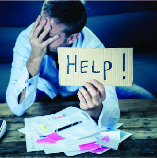 Man frustrated over finances holds up a help sign