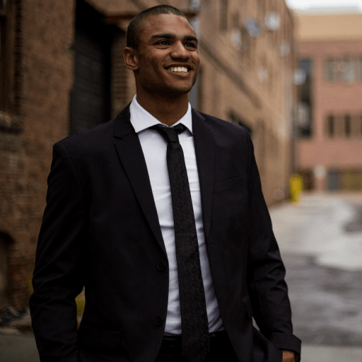 young man in a suit smiling