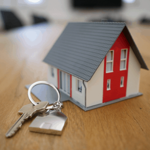 Photo of a miniature house with a key ring