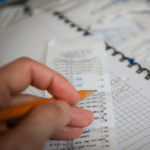 Man reviewing receipts for tax deductions