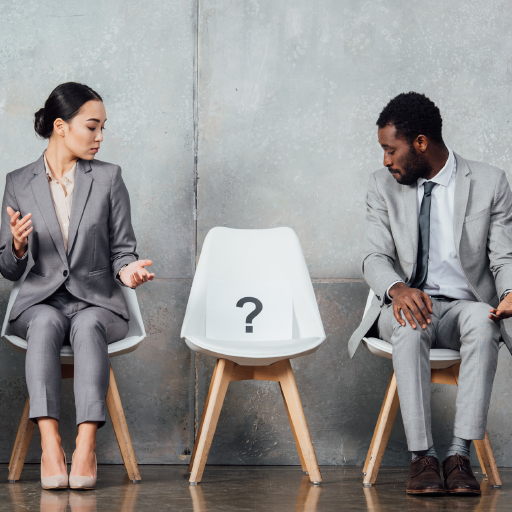 Do I need and accountant? Business man and woman looking at empty chair